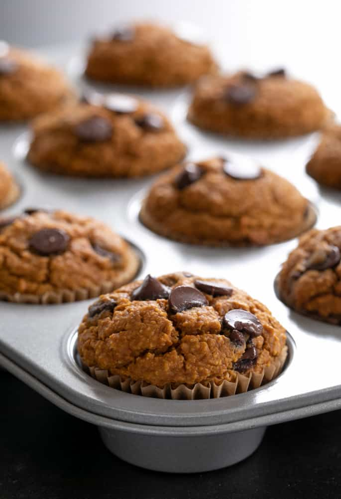 Healthy pumpkin breakfast muffins baked in muffin tin.