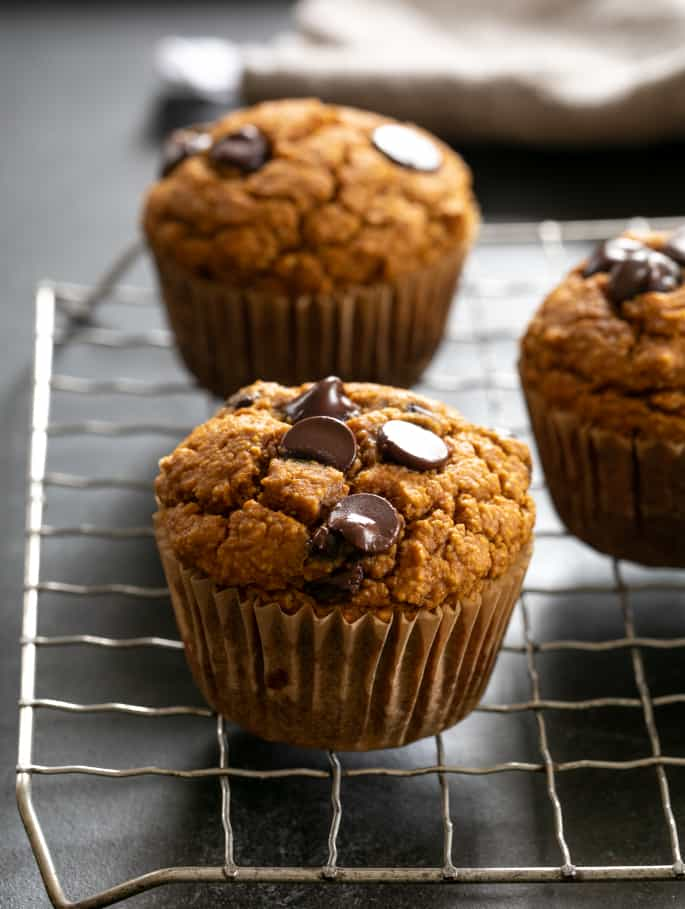 Healthy pumpkin breakfast muffins baked and on a wire rack.