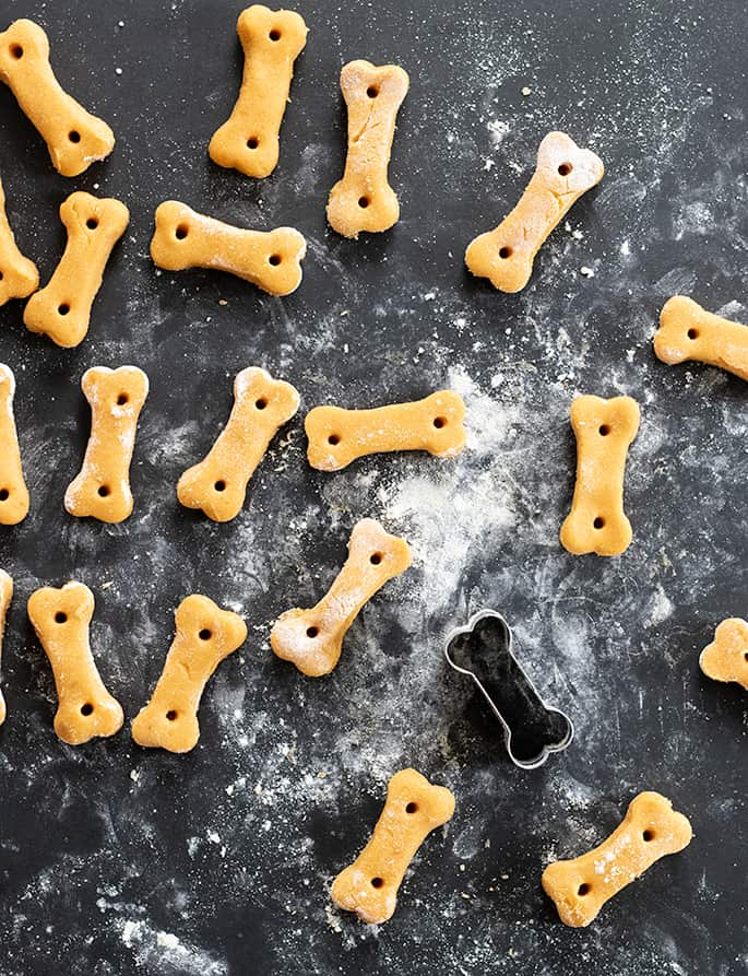 Image of raw, shaped crunchy gluten free dog treats with cookie cutter.