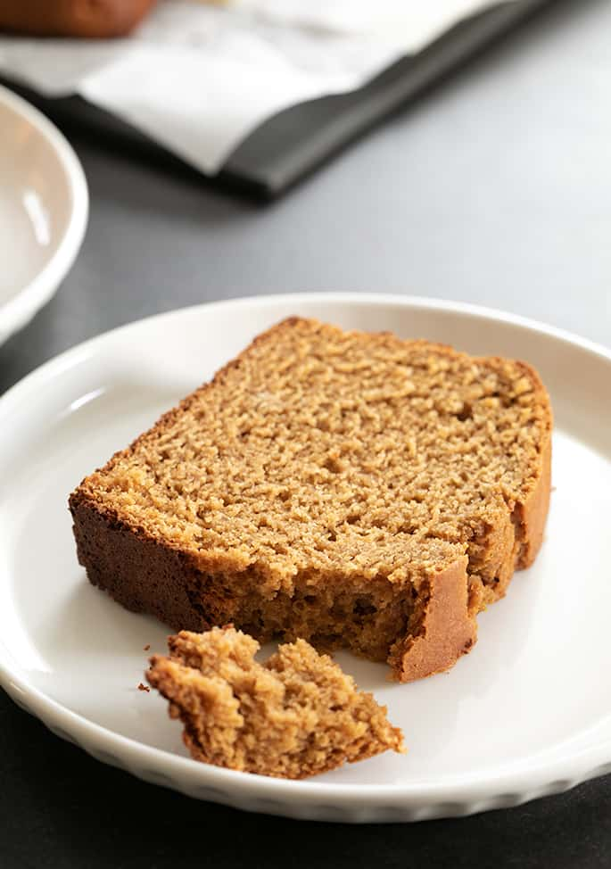 Closeup image of a slice of gluten free gingerbread loaf, showing the tenderness of the crumb.