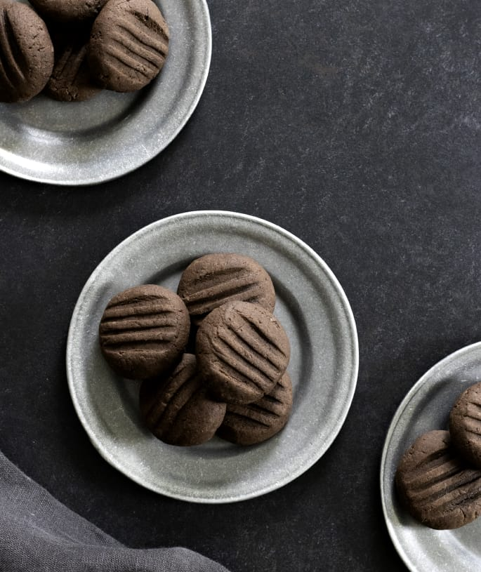 Plated and served chocolate gluten free meltaway cookies.