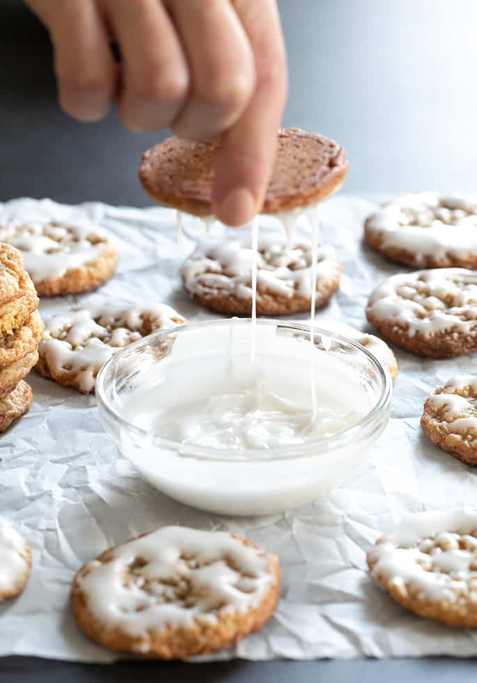Icing dripping off of gluten free iced oatmeal cookies