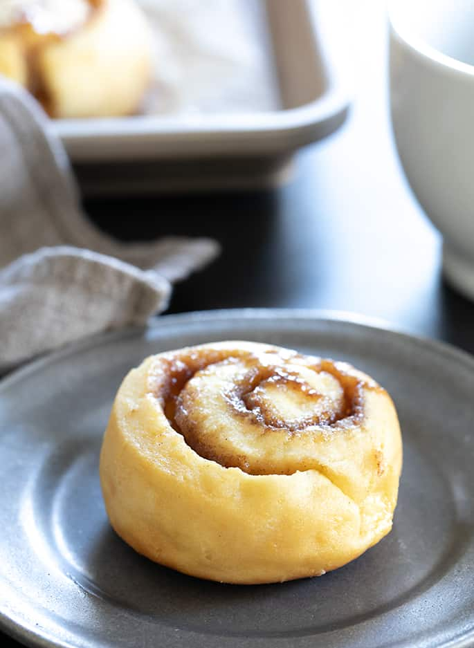 Plated easy gluten free cinnamon rolls made without yeast but tasting just like they did.