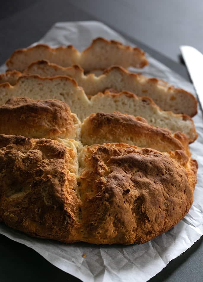 Gluten free savory Irish soda bread sliced from behind.