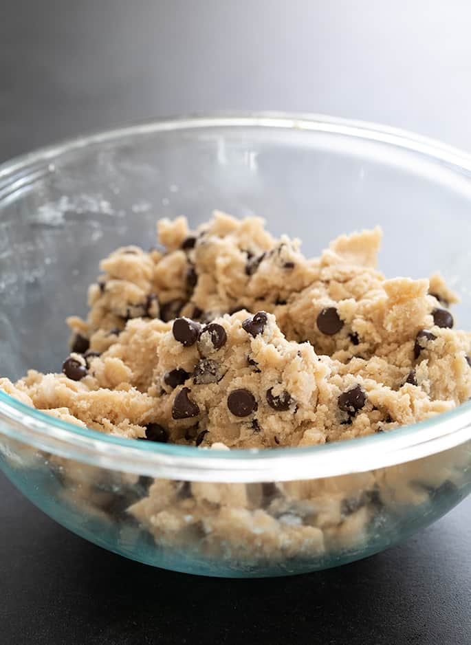 Raw cookie dough for vegan gluten free chocolate chip cookies.