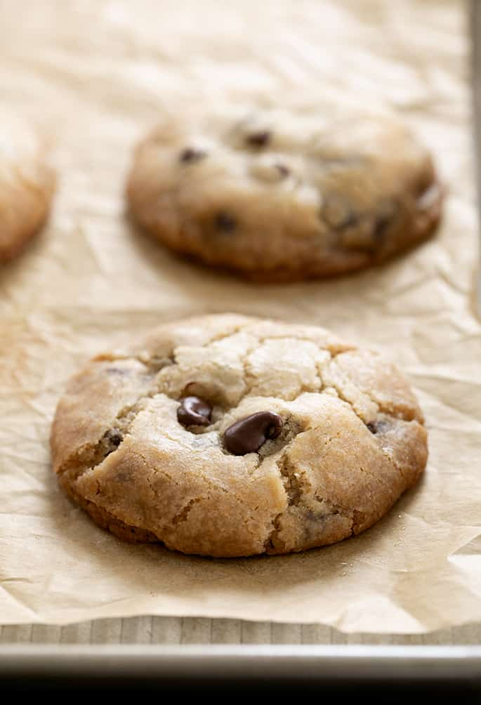 Just baked vegan gluten free chocolate chip cookies, with texture visible close up.
