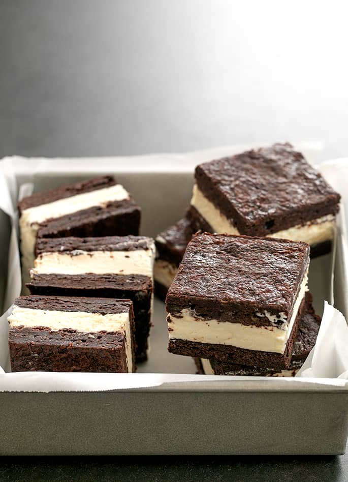 Brownie ice cream sandwiches piled in square baking dish