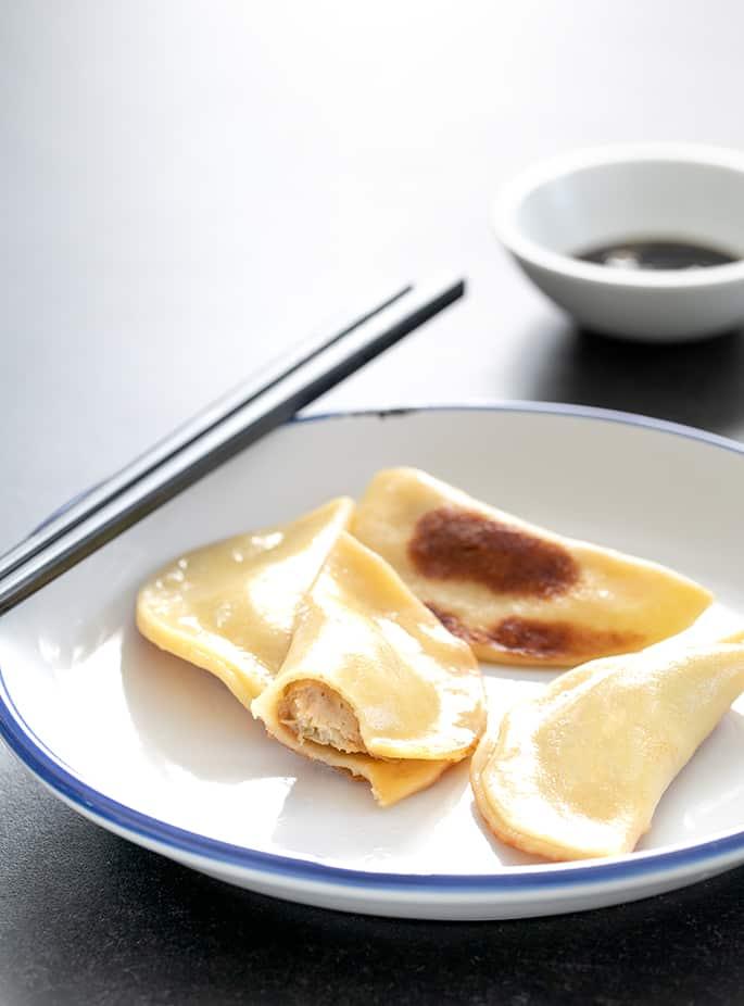 Gluten free potstickers on a plate, showing inside.
