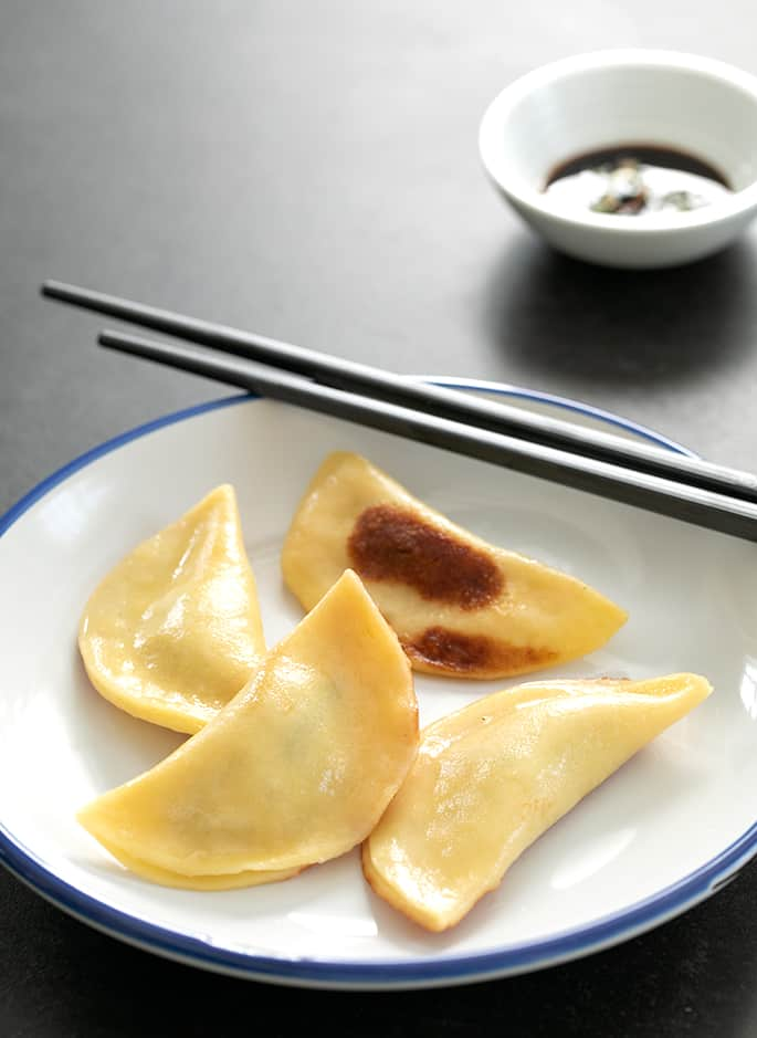 Potstickers served on a plate