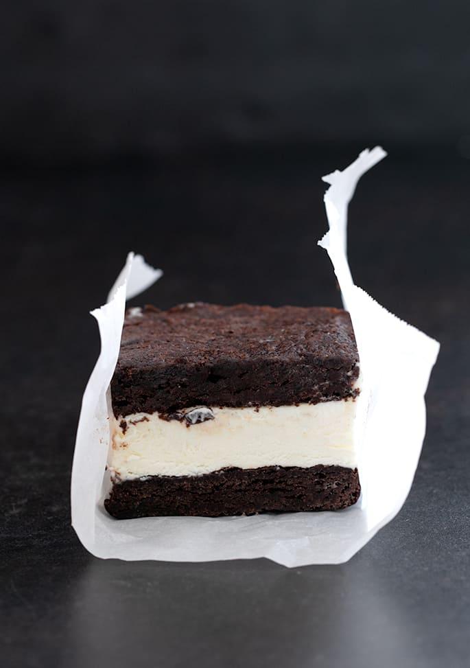 single brownie ice cream sandwich in paper