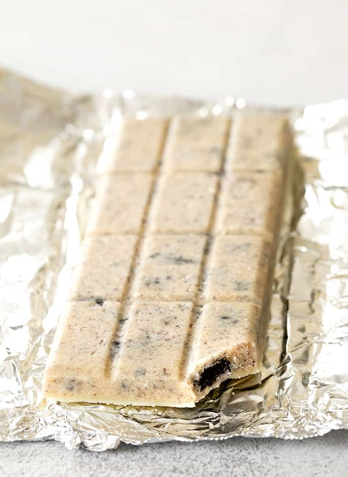 Cookies n cream bar on foil with bite from corner