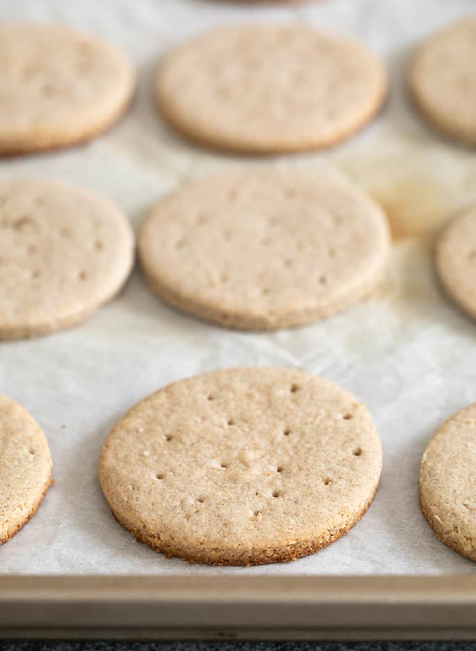 Digestive biscuits baked on white paper on tray