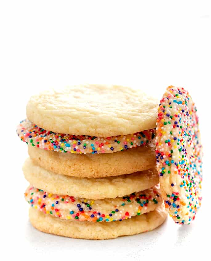 Stack of bakery style sugar cookies with one on its side