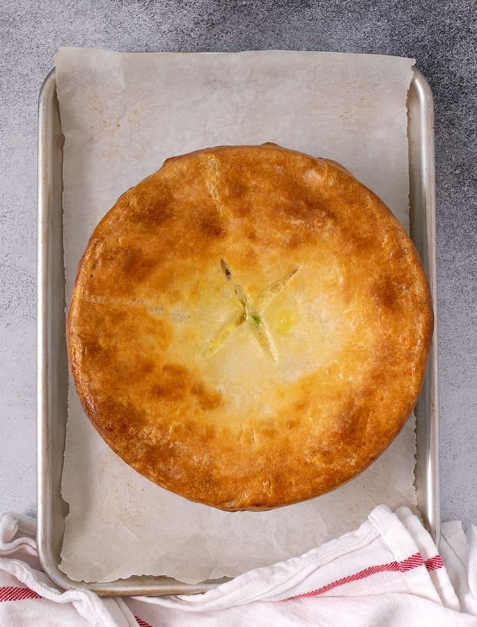 Baked pie crust on round white casserole dish