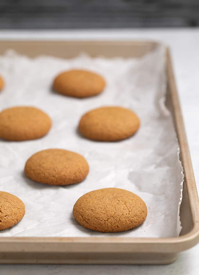 Gingersnaps baked on white paper on tray