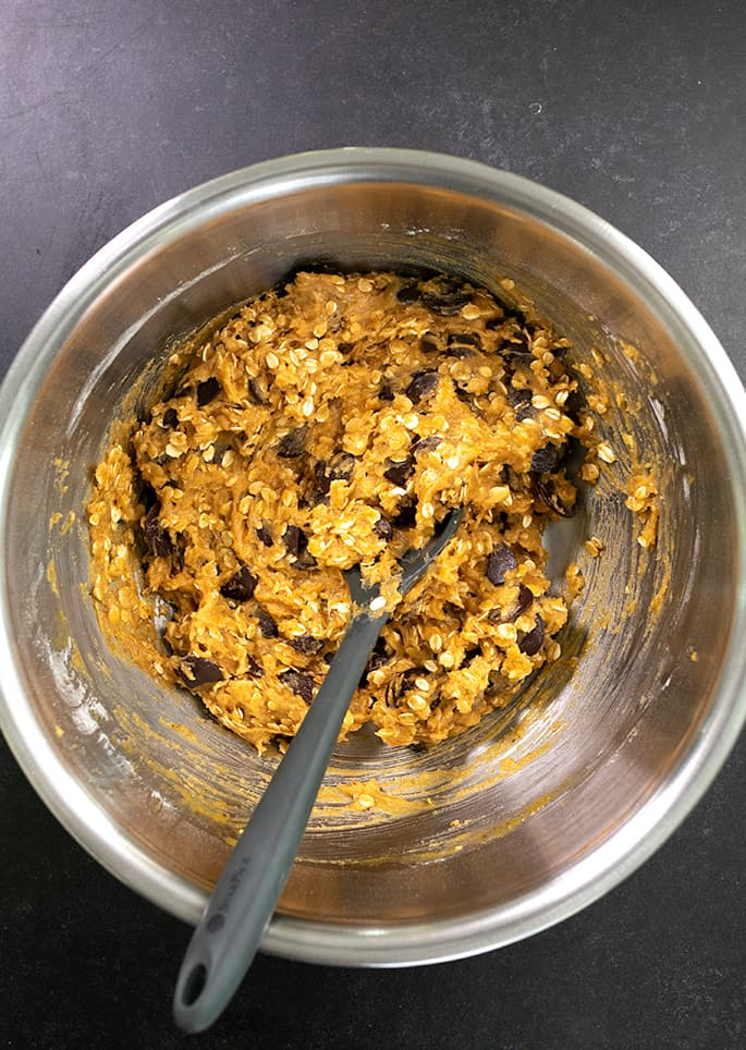 Pumpkin Oatmeal Cookie dough in a bowl with a mixing spoon