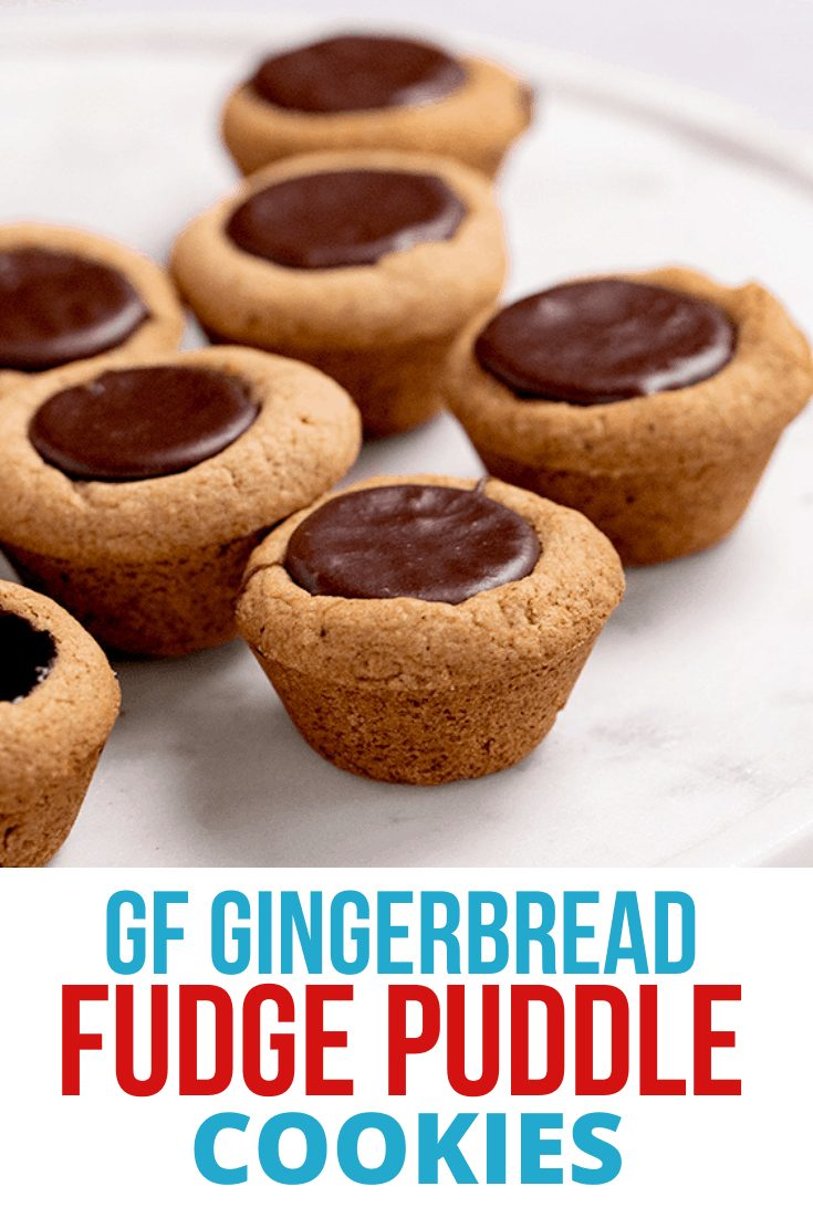 Gingerbread fudge puddle cookies on a round marble platter with writing that says GF Gingerbread Fudge Puddle Cookies