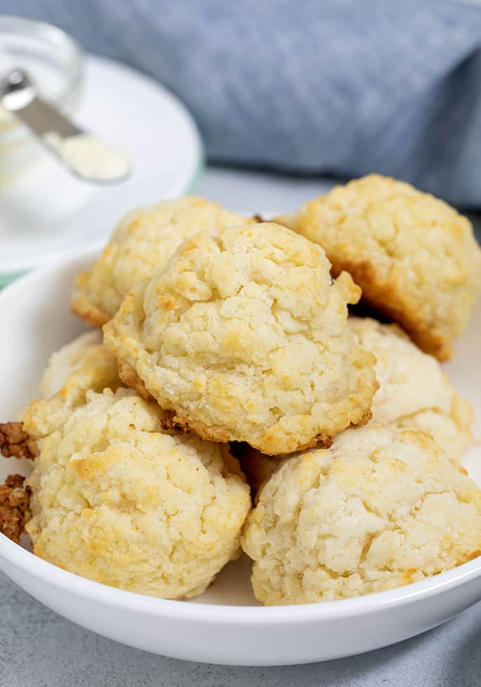 White bowl full of baked biscuits in a pile
