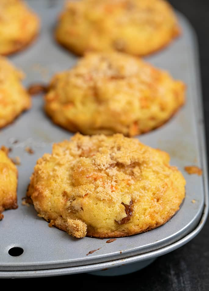 6 carrot muffins baked in 6-cup metal muffin tin