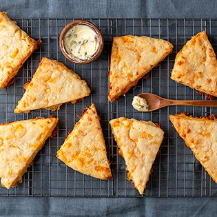 Cheese scones from overhead on wire rack with butter