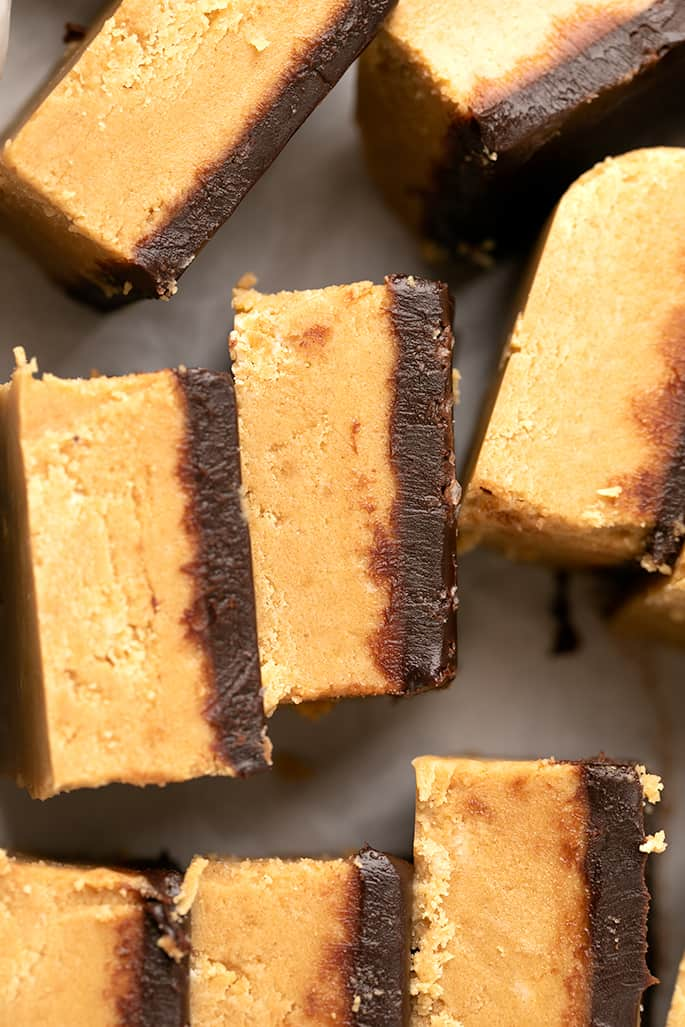 Overhead image of chocolate topped peanut butter bars on their sides