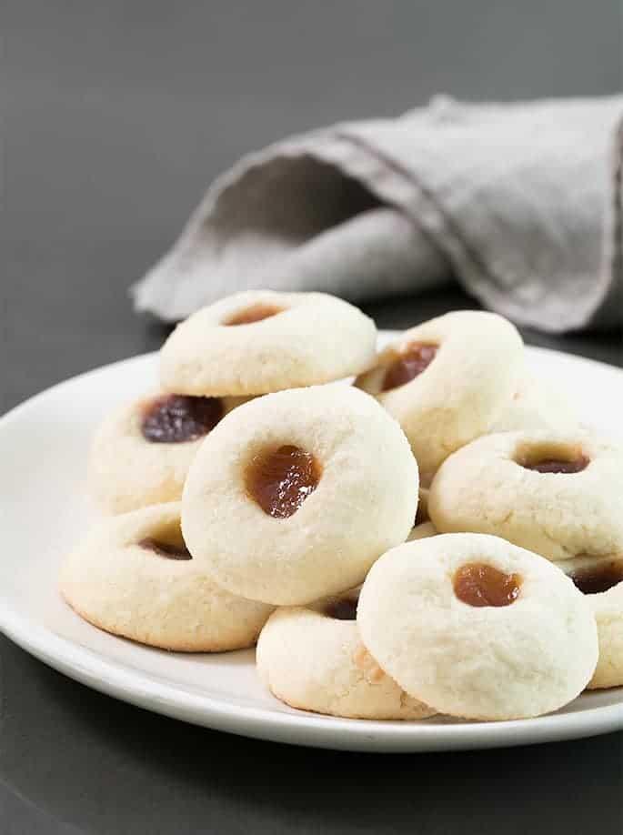 A doughnut on a plate, with Gluten