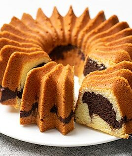 Marble bundt cake with 2 slices on platter 315x315