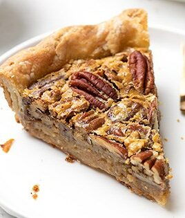 Small image of slice of GF pecan pie with fork on white plate