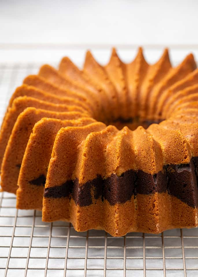 Whole marble bundt cake on wire rack